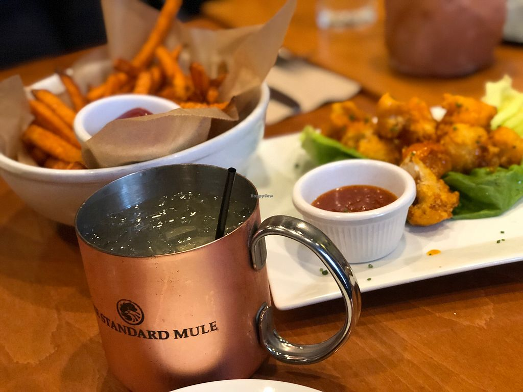 """Photo of Sweet Grass Grill  by <a href=""""/members/profile/westchestervegan"""">westchestervegan</a> <br/>Sweet potato fries and buffalo cauliflower bites  <br/> May 18, 2018  - <a href='/contact/abuse/image/33020/401215'>Report</a>"""