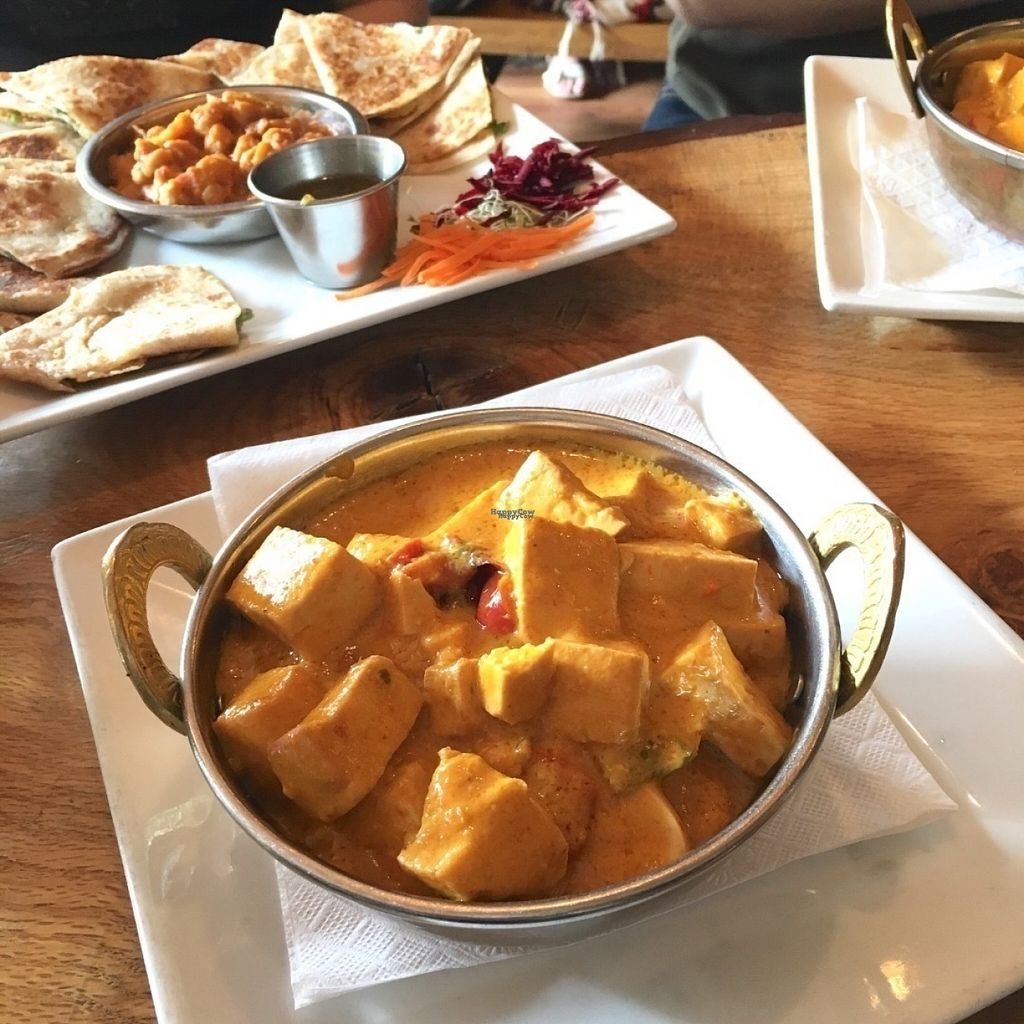 "Photo of East is East - Broadway  by <a href=""/members/profile/vegan%20frog"">vegan frog</a> <br/>Vegan mango curry (front) and boulani (back) <br/> August 8, 2016  - <a href='/contact/abuse/image/33133/166767'>Report</a>"
