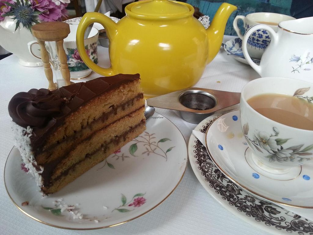 """Photo of Norman's Coach and Horses  by <a href=""""/members/profile/Miggi"""">Miggi</a> <br/>Vegan chocolate and coconut cake with tea in the secret tearoom <br/> May 12, 2014  - <a href='/contact/abuse/image/33232/69855'>Report</a>"""