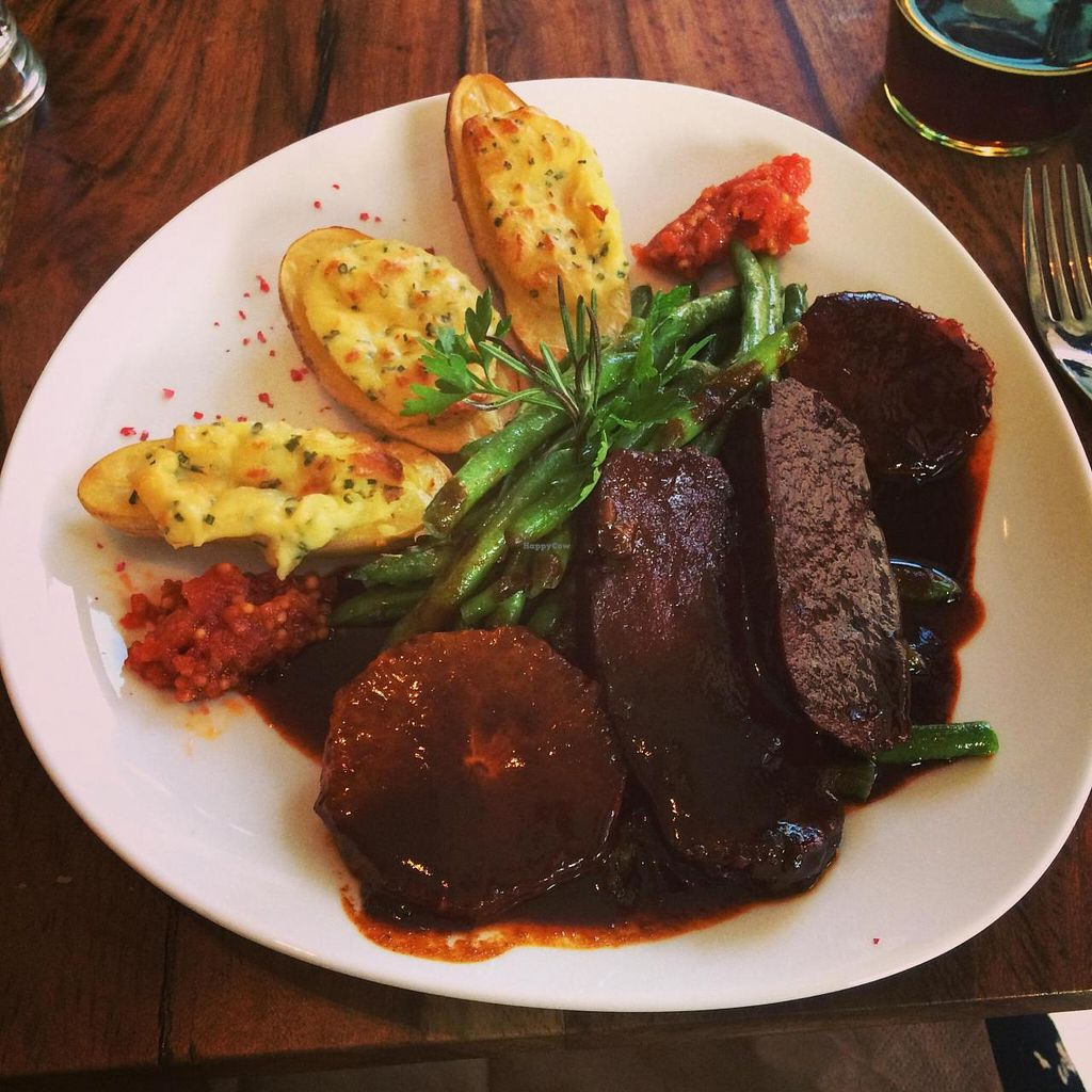 """Photo of Bistro Bardot  by <a href=""""/members/profile/lusciouslex"""">lusciouslex</a> <br/>Homemade seitan medallions with stuffed potatoes, green beens and orange and rosemary sauce <br/> July 22, 2014  - <a href='/contact/abuse/image/33408/74679'>Report</a>"""