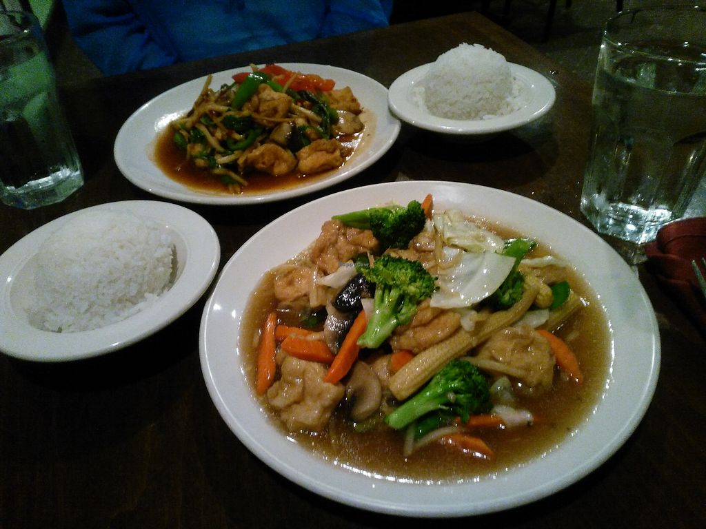 """Photo of Bua Thai Cuisine  by <a href=""""/members/profile/Runo"""">Runo</a> <br/>Tofu and veggies with light garlic sauce in the front, tofu with basil leaves in the back.  <br/> August 8, 2017  - <a href='/contact/abuse/image/33459/290308'>Report</a>"""