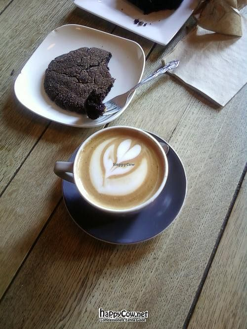 """Photo of Bean Scene Coffee Works  by <a href=""""/members/profile/DollyWiggles"""">DollyWiggles</a> <br/>yummy almond milk latte and mexican chocolate cookie <br/> July 28, 2012  - <a href='/contact/abuse/image/33564/35208'>Report</a>"""