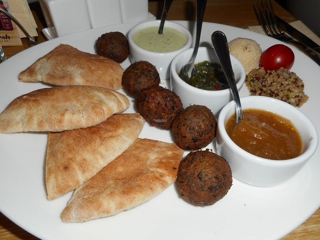 """Photo of Fresh - Bolshaya Dmitrovka  by <a href=""""/members/profile/J%20and%20J"""">J and J</a> <br/>falafel with assortment of sauces <br/> August 30, 2016  - <a href='/contact/abuse/image/33756/172310'>Report</a>"""