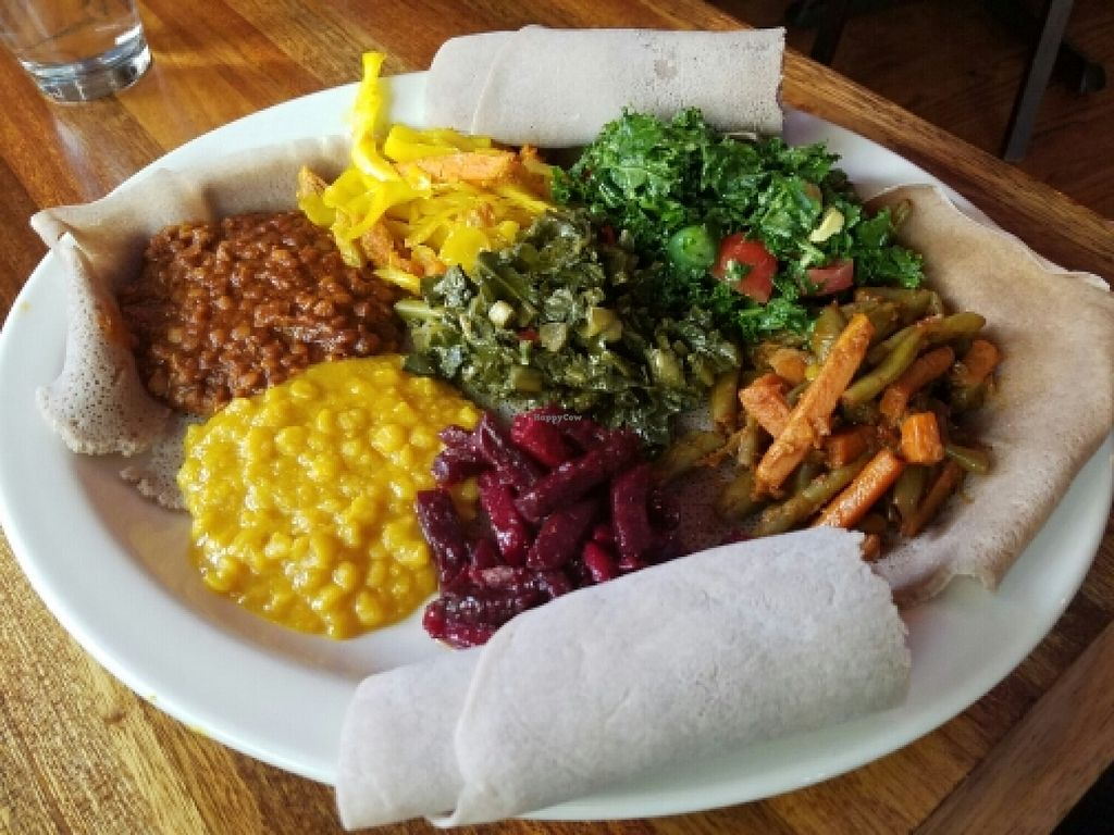 "Photo of Bunna Cafe  by <a href=""/members/profile/kenvegan"">kenvegan</a> <br/>Vegan combination plate <br/> June 24, 2016  - <a href='/contact/abuse/image/34274/155886'>Report</a>"