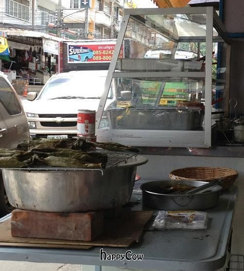"""Photo of Youta Vegetarian Food Stall  by <a href=""""/members/profile/ArtinHeaven"""">ArtinHeaven</a> <br/>Dessert: delicious charcoal baked sticky-rice with yams or bananas, wrapped in banana leaves <br/> September 30, 2012  - <a href='/contact/abuse/image/34469/38586'>Report</a>"""