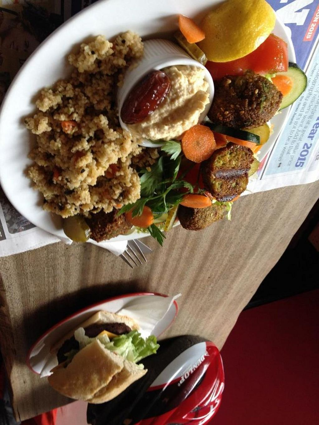 "Photo of CLOSED: CB1 Internet Cafe  by <a href=""/members/profile/chapstick"">chapstick</a> <br/>Two of the recent specials. Vegan delight salad (felafel, hummus, couscous, veggies, olives, pickles, lemon & a date) and vegan cheeze burger. Both excellent.  <br/> May 15, 2015  - <a href='/contact/abuse/image/34488/102294'>Report</a>"