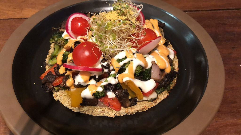 "Photo of The Living Cafe  by <a href=""/members/profile/AmyLeySzeThoo"">AmyLeySzeThoo</a> <br/>Raw pizza  <br/> May 9, 2018  - <a href='/contact/abuse/image/34812/397195'>Report</a>"