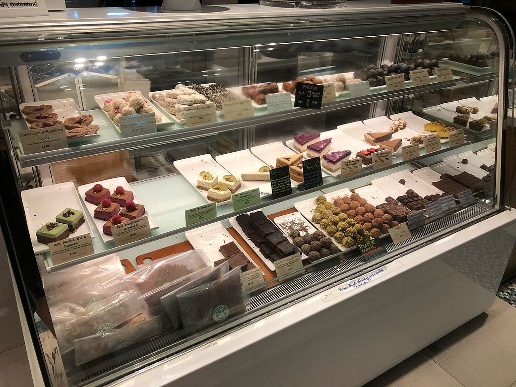"Photo of The Living Cafe  by <a href=""/members/profile/AmyLeySzeThoo"">AmyLeySzeThoo</a> <br/>Dessert selection (not all vegan) <br/> May 12, 2018  - <a href='/contact/abuse/image/34812/398565'>Report</a>"
