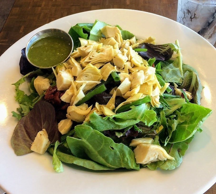 "Photo of Naked Cafe  by <a href=""/members/profile/fullbellyhappyheart"">fullbellyhappyheart</a> <br/>Baby Reds and Greens salad with artichoke hearts, sun-dried tomatoes and onions with basil dressing <br/> June 20, 2017  - <a href='/contact/abuse/image/35143/271213'>Report</a>"