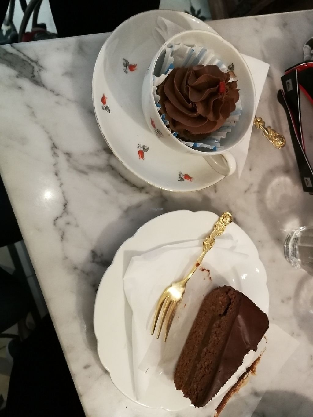 """Photo of Simply Raw Bakery and Bistro  by <a href=""""/members/profile/girltriesvegan"""">girltriesvegan</a> <br/>vegan cupcake and sachertorte <br/> April 18, 2017  - <a href='/contact/abuse/image/35149/249703'>Report</a>"""