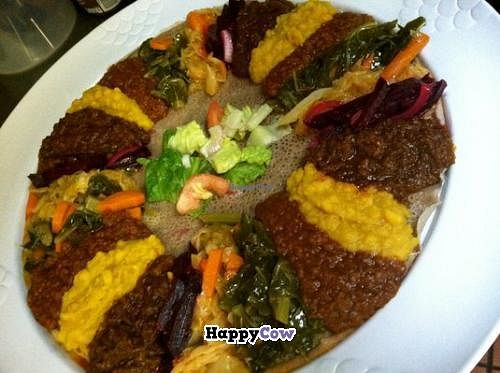 "Photo of Sheba Ethiopian Restaurant  by <a href=""/members/profile/kenvegan"">kenvegan</a> <br/>Vegan Ethiopian Platter for 4 People <br/> September 26, 2013  - <a href='/contact/abuse/image/35212/55725'>Report</a>"