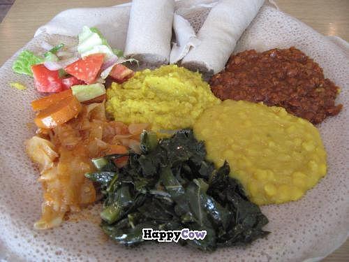 "Photo of Sheba Ethiopian Restaurant  by <a href=""/members/profile/kenvegan"">kenvegan</a> <br/>Vegan Ethiopian Platter  at Sheba Ethiopian Restaurant <br/> September 26, 2013  - <a href='/contact/abuse/image/35212/55762'>Report</a>"