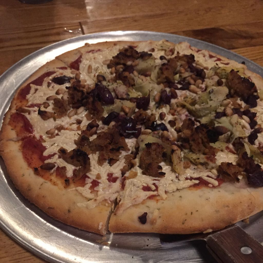 "Photo of The Mitten Brewing Co.  by <a href=""/members/profile/happycowgirl"">happycowgirl</a> <br/>gluten free, vegan cheese, vegan Italian sausage, pine nuts, & artichokes pizza <br/> July 22, 2016  - <a href='/contact/abuse/image/35489/161493'>Report</a>"