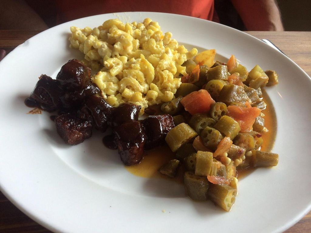 "Photo of Southern Charm Kitchen  by <a href=""/members/profile/kmilitello"">kmilitello</a> <br/>BBQ Tempeh, vegan Mac & Cheese, okra and tomatoes <br/> October 22, 2014  - <a href='/contact/abuse/image/35549/83667'>Report</a>"