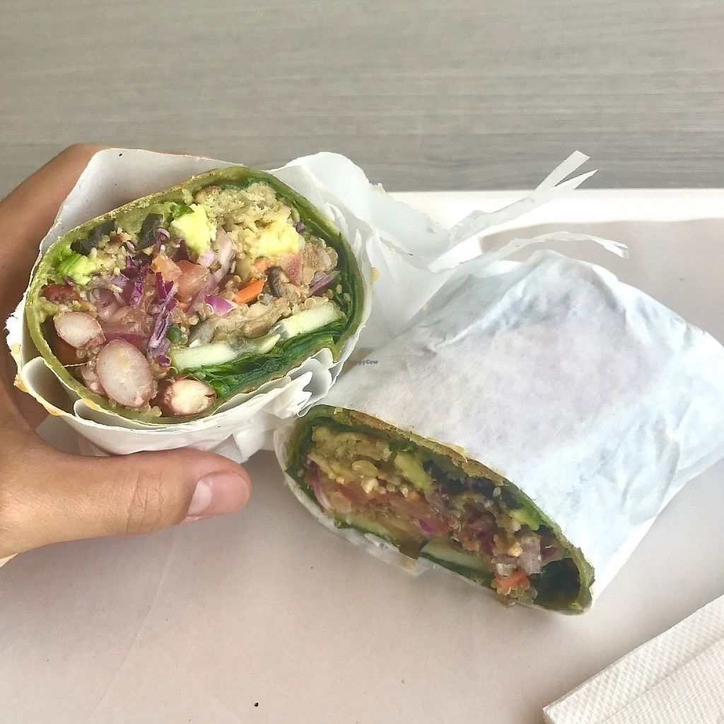 """Photo of Gokela  by <a href=""""/members/profile/NR105176"""">NR105176</a> <br/>Their vegan """"meat"""" was some kind of falafel-like patty and I added beans, quinoa, avocados, pico de gallo, red cabbage, cucumbers, olives, crushed almonds and sesame seeds with a sesame dressing wrapped in a spinach wrap. I made sure to tell her that I was """"vegano"""" and repeatedly made sure nothing had any """"huevos"""" or """"leche"""" or """"queso"""" haha. She was completely understanding and helpful. They usually allow just 4 ingredients + the """"meat"""" + 2 nuts for under $6 but I went ahead and added extra ingredients and """"premium"""" ingredients like the avocados and olives. Along with a bottle of water my total was a little over $9. Prices I used are USD. I'm sure you can also just make it a salad without the wrap which I plan on doing if I eat here again <br/> May 25, 2017  - <a href='/contact/abuse/image/35715/262504'>Report</a>"""