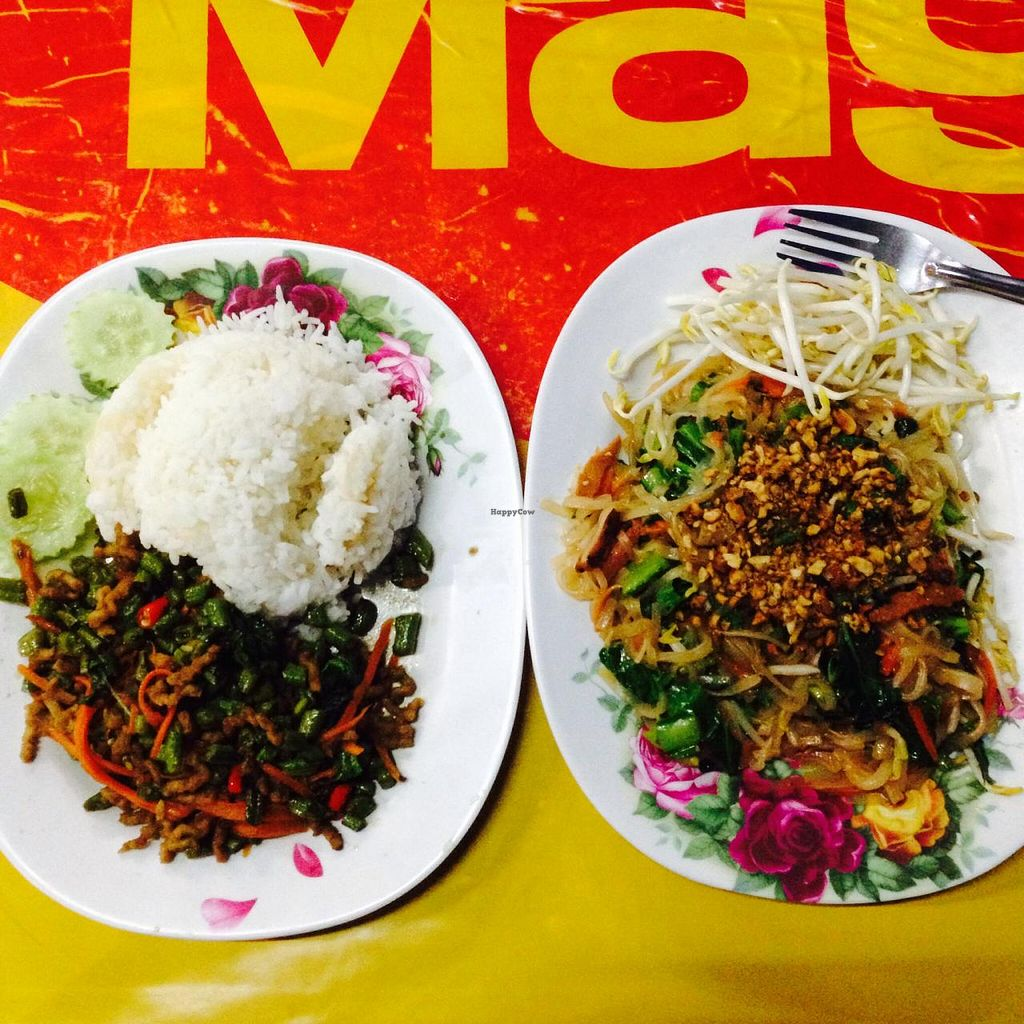 "Photo of Nong Jay  by <a href=""/members/profile/jasbanana"">jasbanana</a> <br/>Left - veggies with fresh basil. I believe there was some sort of moc meat too. Right - pad  thai  <br/> February 4, 2015  - <a href='/contact/abuse/image/35860/92191'>Report</a>"