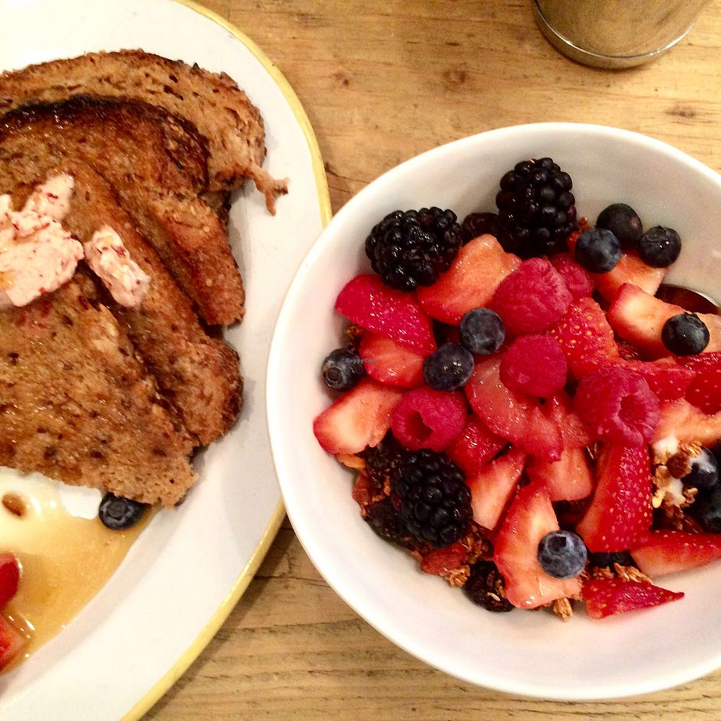 """Photo of The Butcher's Daughter - Nolita  by <a href=""""/members/profile/thecharlotte"""">thecharlotte</a> <br/>Vegan French toast and Granola/Berry bowl  <br/> August 24, 2017  - <a href='/contact/abuse/image/35872/296582'>Report</a>"""