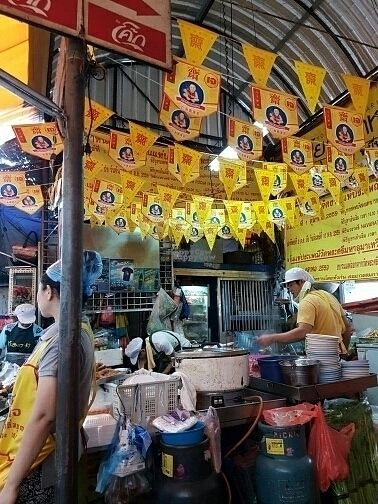 """Photo of Vegan Thai Food Stalls  by <a href=""""/members/profile/Lep10"""">Lep10</a> <br/>Veggie food stall with yellow flags  <br/> September 20, 2016  - <a href='/contact/abuse/image/35874/176965'>Report</a>"""