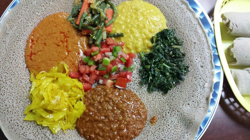 Photo of Mahider Ethiopian Restaurant  by Navegante <br/>Veg (vegan) platter, Oct 2014 <br/> November 2, 2014  - <a href='/contact/abuse/image/36187/84407'>Report</a>