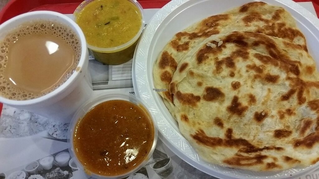 """Photo of Komala's Restaurant - ARC  by <a href=""""/members/profile/JimmySeah"""">JimmySeah</a> <br/>2 pieces of plain Prata and milk tea for breakfast  <br/> February 28, 2017  - <a href='/contact/abuse/image/36281/231262'>Report</a>"""