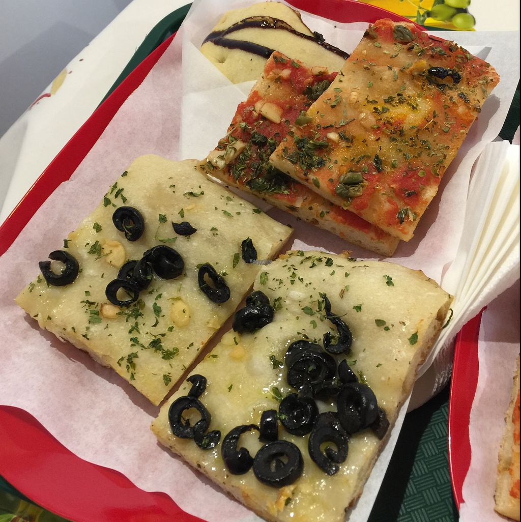 """Photo of Primo Basilico  by <a href=""""/members/profile/vegetariangirl"""">vegetariangirl</a> <br/>2 types of vegan pizza with a vegan calzone hiding in the back <br/> October 9, 2016  - <a href='/contact/abuse/image/36324/180853'>Report</a>"""