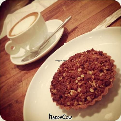 """Photo of Cafe Pinson - Marais  by <a href=""""/members/profile/Kardinal"""">Kardinal</a> <br/>Cappuccino with almond milk, and Cinnamon & Apple Crumble Pie  <br/> January 19, 2013  - <a href='/contact/abuse/image/36460/43150'>Report</a>"""