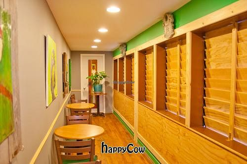 """Photo of Mead's Green Door Cafe  by <a href=""""/members/profile/spiceislandvegan"""">spiceislandvegan</a> <br/>Side patio/art gallery with wood plantation shutter <br/> February 17, 2013  - <a href='/contact/abuse/image/36604/44321'>Report</a>"""
