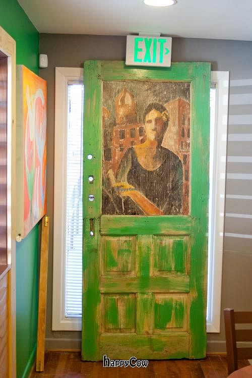"""Photo of Mead's Green Door Cafe  by <a href=""""/members/profile/spiceislandvegan"""">spiceislandvegan</a> <br/>Green door, an art, leaning under an Exit sign <br/> February 17, 2013  - <a href='/contact/abuse/image/36604/44322'>Report</a>"""