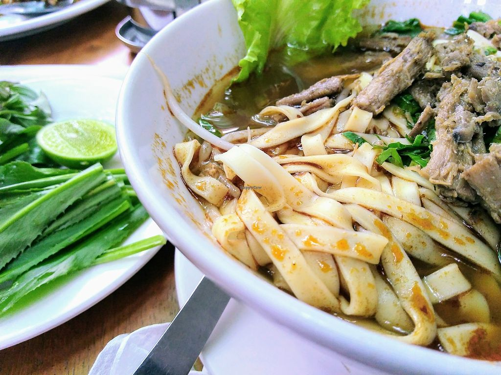 """Photo of Mercy House  by <a href=""""/members/profile/PANGOlin"""">PANGOlin</a> <br/>Noodle soup with mushroom 'steak' chunks & selection of fresh herbs <br/> April 7, 2018  - <a href='/contact/abuse/image/36711/381860'>Report</a>"""