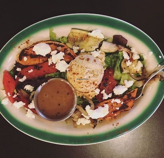 "Photo of Brews N Bytes Internet Cafe and Eatery  by <a href=""/members/profile/Happycaitlin"">Happycaitlin</a> <br/>The hummus salad served with grilled seasonal vegetables, a dollop of hummus and sprinkled with feta <br/> August 3, 2017  - <a href='/contact/abuse/image/3700/288236'>Report</a>"