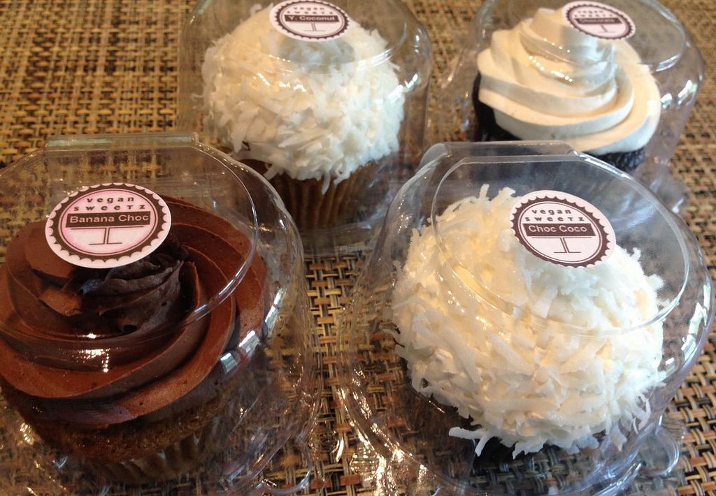 """Photo of Sweetz Bakery  by <a href=""""/members/profile/Alysoun%20Mahoney"""">Alysoun Mahoney</a> <br/>Sweetz Bakery Leesburg VA USA.  These are just a few of many vegan cupcake flavors offered - banana with chocolate frosting, chocolate coconut, yellow coconut, and chocolate cream.  <br/> June 20, 2015  - <a href='/contact/abuse/image/37362/106636'>Report</a>"""
