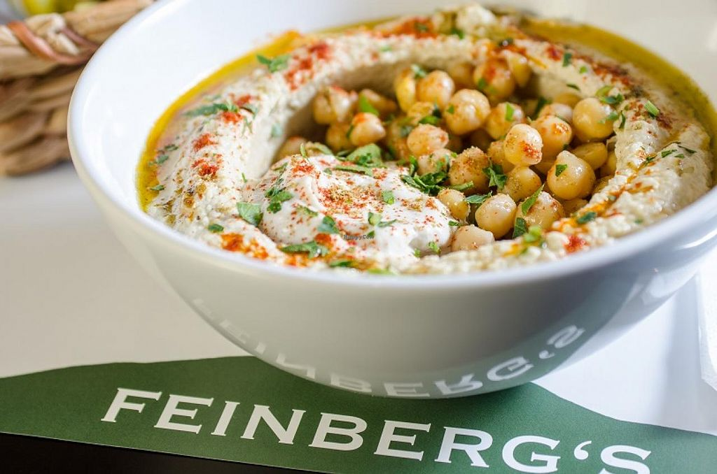 """Photo of Feinberg's  by <a href=""""/members/profile/Feinbergs%20Berlin"""">Feinbergs Berlin</a> <br/>Hummus with chickpeas and Tahini <br/> March 21, 2015  - <a href='/contact/abuse/image/37533/96420'>Report</a>"""