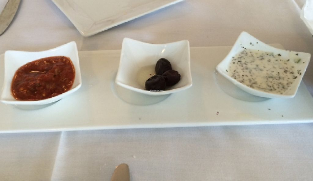 """Photo of Istanbul Restaurant  by <a href=""""/members/profile/Missjez"""">Missjez</a> <br/>dipping sauces and olives with home made bread. Red sauce is vegan and spicy, white sauce vegetarian not vegan <br/> July 27, 2016  - <a href='/contact/abuse/image/37592/232783'>Report</a>"""