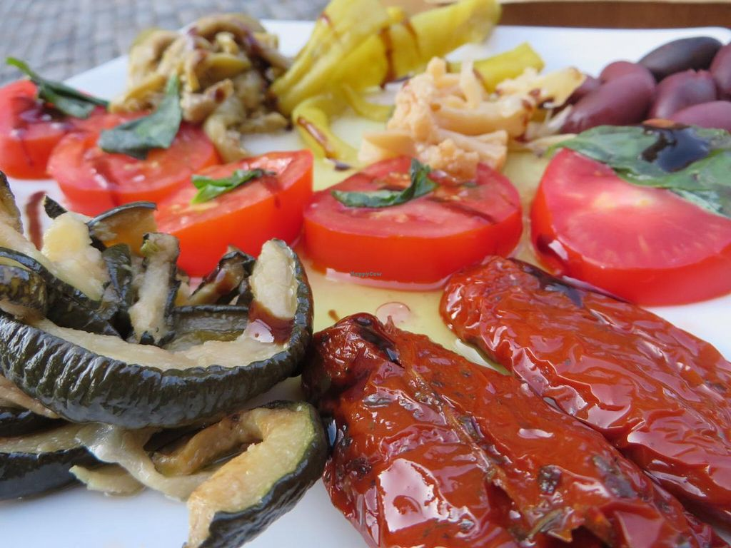 "Photo of Cafeteria-Trattoria Am Rathaus  by <a href=""/members/profile/VegiAnna"">VegiAnna</a> <br/>V4: Antipasto verde vegano (mixed platter with appetizers), served with rosmary bread <br/> August 7, 2014  - <a href='/contact/abuse/image/37663/76205'>Report</a>"