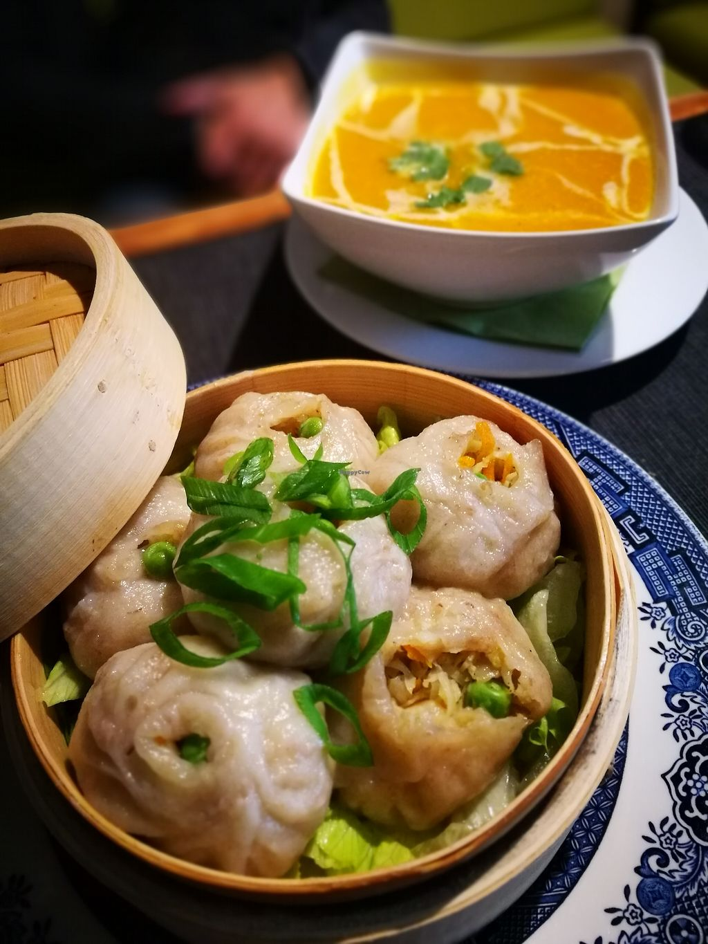 "Photo of Pod Norenami  by <a href=""/members/profile/k-girl80"">k-girl80</a> <br/>two first courses: far back - seasonal pumpking soup, up front - Momo, which is a type of South Asian dumpling <br/> October 12, 2017  - <a href='/contact/abuse/image/37682/314530'>Report</a>"