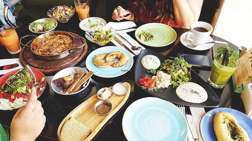 """Photo of Meshek Barzilay  by <a href=""""/members/profile/youcansavethem"""">youcansavethem</a> <br/>Royal Couple Brunch and Tivonina (black dish and focaccia on the right side) <br/> April 16, 2018  - <a href='/contact/abuse/image/37930/386886'>Report</a>"""