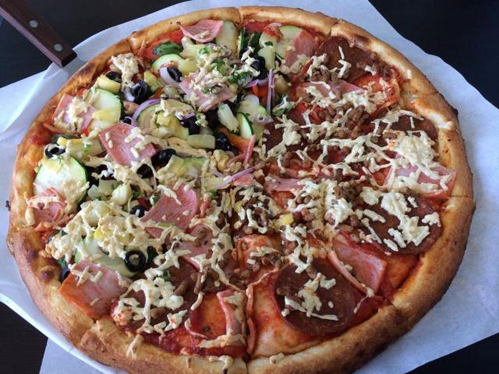 """Photo of Vegan Pizza  by <a href=""""/members/profile/cha-yen%20monster"""">cha-yen monster</a> <br/>half ultimate combo / half meat lovers <br/> June 22, 2014  - <a href='/contact/abuse/image/38016/72531'>Report</a>"""