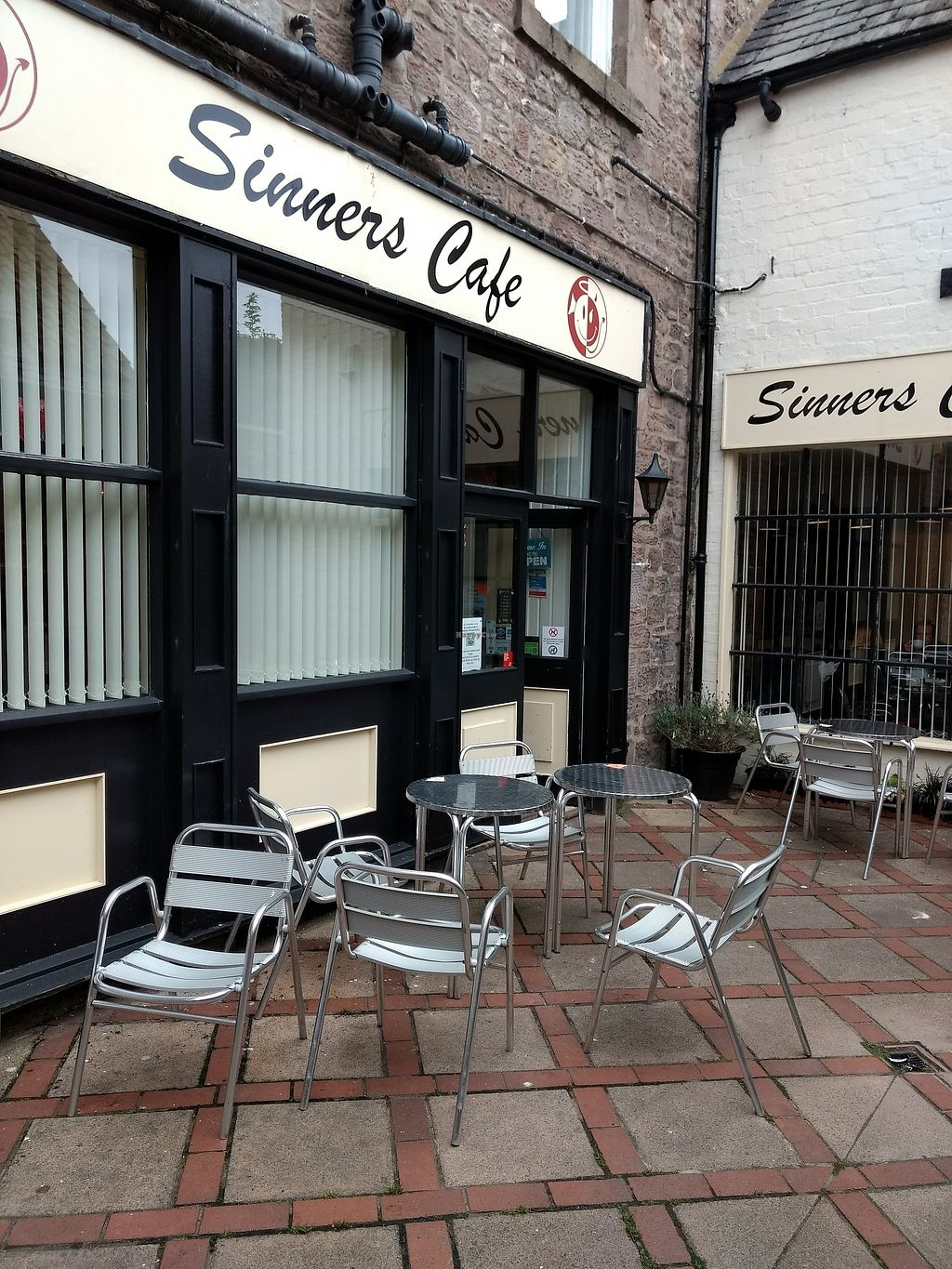 "Photo of Sinners Cafe  by <a href=""/members/profile/craigmc"">craigmc</a> <br/>you could sit here if it was sunny <br/> July 26, 2017  - <a href='/contact/abuse/image/38242/285165'>Report</a>"