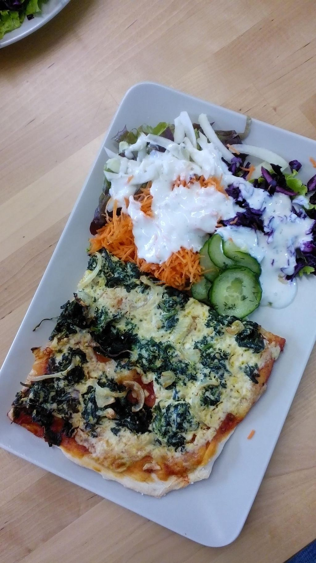 """Photo of CLOSED: Immergruen Bistro and Cafe  by <a href=""""/members/profile/Yilla"""">Yilla</a> <br/>Pizza with salad  <br/> May 18, 2015  - <a href='/contact/abuse/image/38251/102643'>Report</a>"""