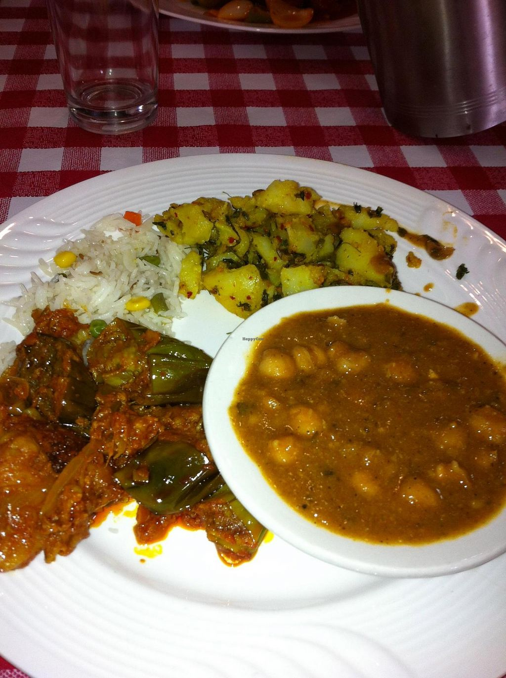 "Photo of Village of India  by <a href=""/members/profile/Little%20Laura"">Little Laura</a> <br/>We went by this restaurant on the way back from visiting the Cheltenham Badlands.  When I walked in I explained that I was both Gluten free and vegan and by the time I sat to eat the server was already up to speed on what I was looking to know.   <br/> October 5, 2014  - <a href='/contact/abuse/image/38259/82206'>Report</a>"