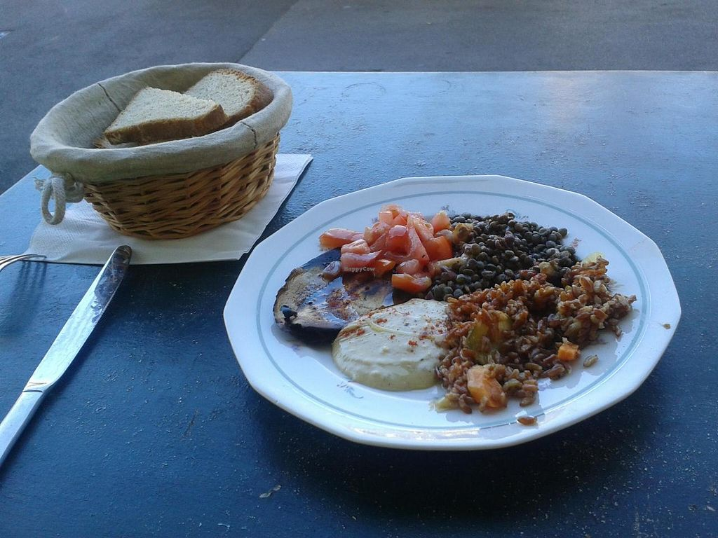 """Photo of L' Ecomotive  by <a href=""""/members/profile/JonJon"""">JonJon</a> <br/>Vegan starter: red rice, hummus, lentils, tomato salad and fried eggplant  Homemade bread <br/> May 25, 2014  - <a href='/contact/abuse/image/38263/70717'>Report</a>"""