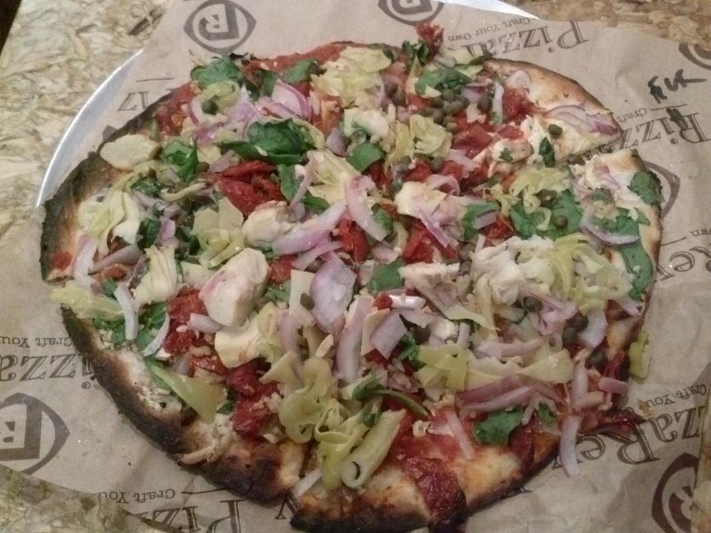 "Photo of PizzaRev  by <a href=""/members/profile/Sonja%20and%20Dirk"">Sonja and Dirk</a> <br/>regular crust, vegan cheese, red sauce, sun dried tomatoes, artichoke hearts, olives, basil, garlic, capers and fresh tomatoes <br/> February 2, 2014  - <a href='/contact/abuse/image/38313/63574'>Report</a>"
