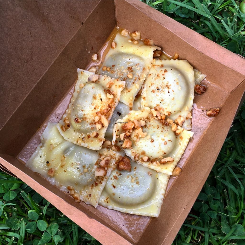 """Photo of Marrickville Farmers Market  by <a href=""""/members/profile/SeitanSeitanSeitan"""">SeitanSeitanSeitan</a> <br/>Gogo Vego's vegan ravioli stuffed with black garlic and potato and served with buttery sauce and caramellised walnuts <br/> April 23, 2016  - <a href='/contact/abuse/image/38412/145929'>Report</a>"""