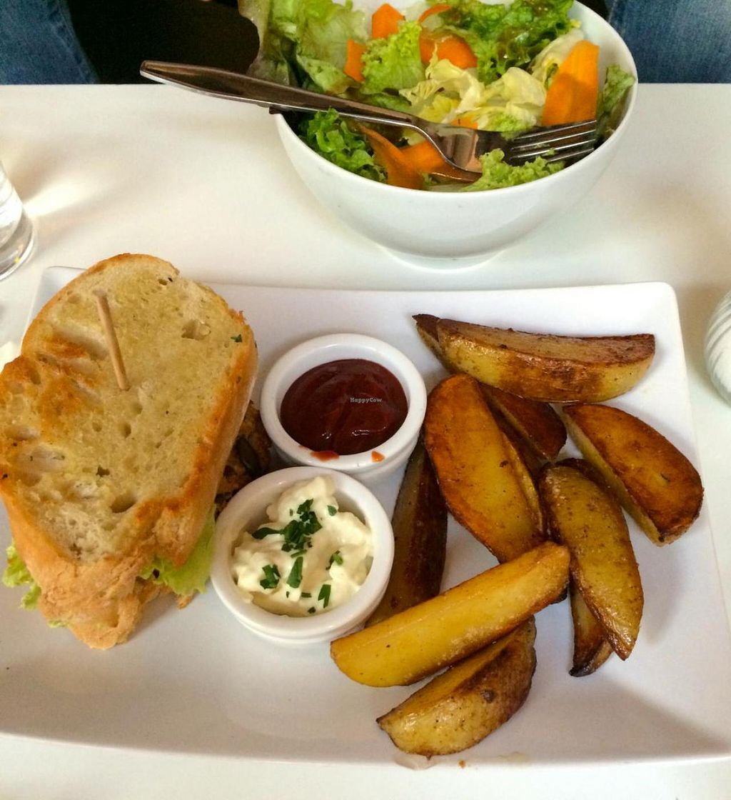 """Photo of Cafe Katzentempel  by <a href=""""/members/profile/Plantpower"""">Plantpower</a> <br/>Burger (could be ordered with normal bun or homemade spelt bread), wedges, and salad. Yum <br/> August 10, 2014  - <a href='/contact/abuse/image/38530/76510'>Report</a>"""