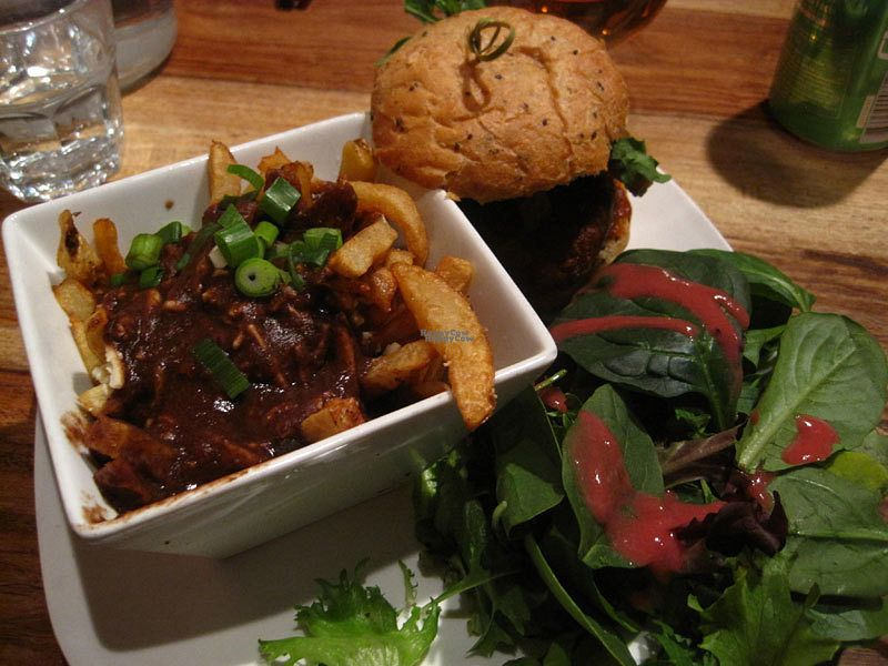 """Photo of Lola Rosa - Parc  by <a href=""""/members/profile/Babette"""">Babette</a> <br/>Cajun burger with a side salad. This is normally served with French fries, but you can transform your fries for a small vegan poutine for just a dollar or two. I really like this dish <br/> October 11, 2016  - <a href='/contact/abuse/image/38742/181280'>Report</a>"""