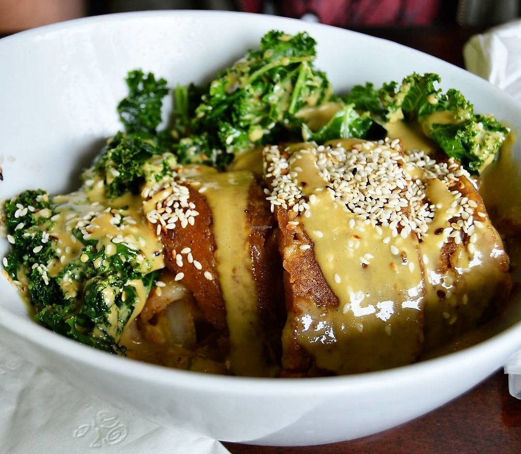 """Photo of Wild Leek  by <a href=""""/members/profile/Vegan%20GiGi"""">Vegan GiGi</a> <br/>Breakfast Bowl at Wild Leek...Seitan bacon, roasted potatoes, sautéed mushrooms & onions, kale, toasted sesame seeds, and dragon sauce. Yum! Breakfast is served everyday until 4pm and comes with a free cup of coffee.  <br/> October 20, 2017  - <a href='/contact/abuse/image/38899/317067'>Report</a>"""