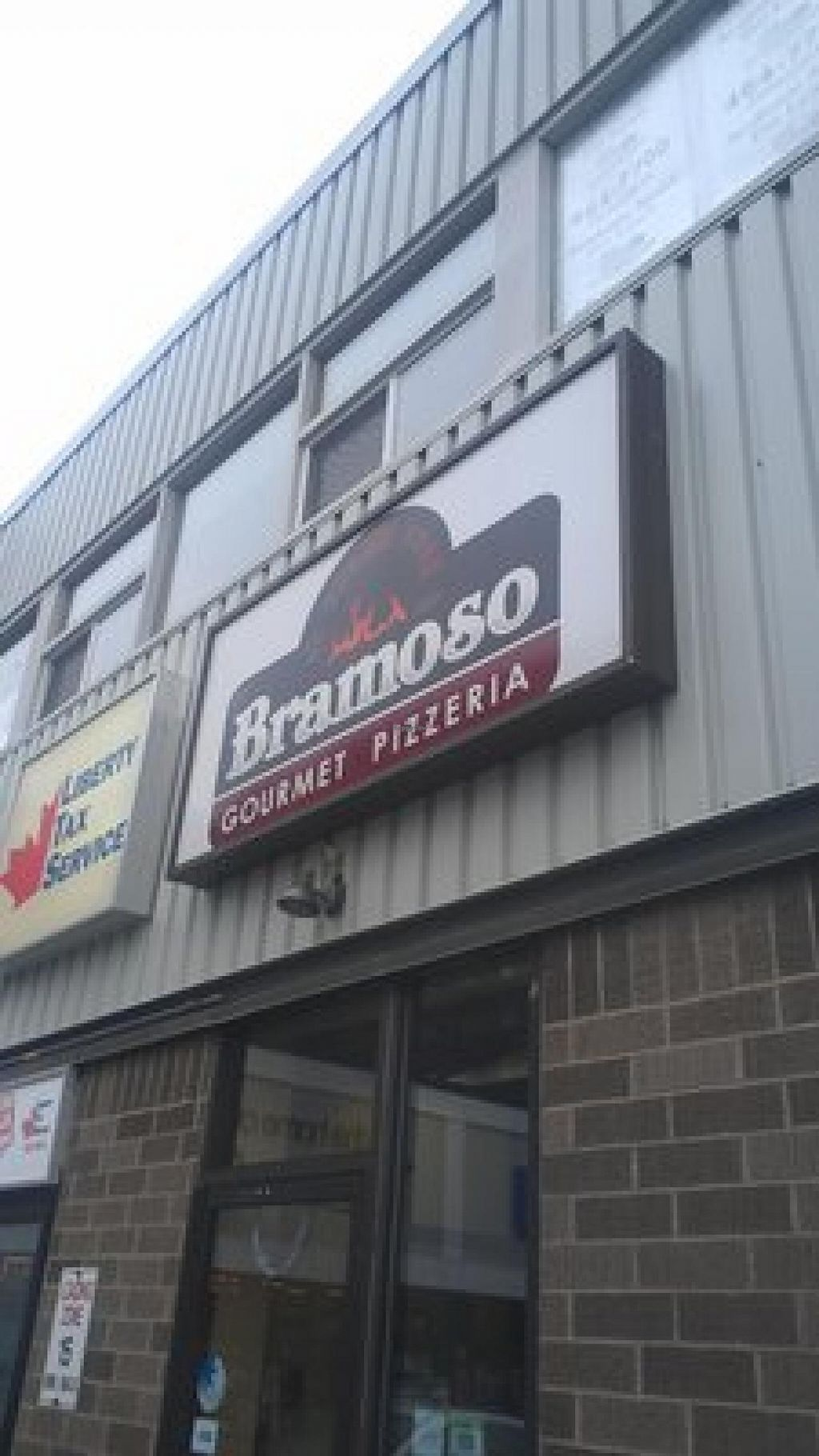 """Photo of Bramoso Pizzeria  by <a href=""""/members/profile/QuothTheRaven"""">QuothTheRaven</a> <br/>Back entrance  <br/> June 14, 2014  - <a href='/contact/abuse/image/38921/72025'>Report</a>"""
