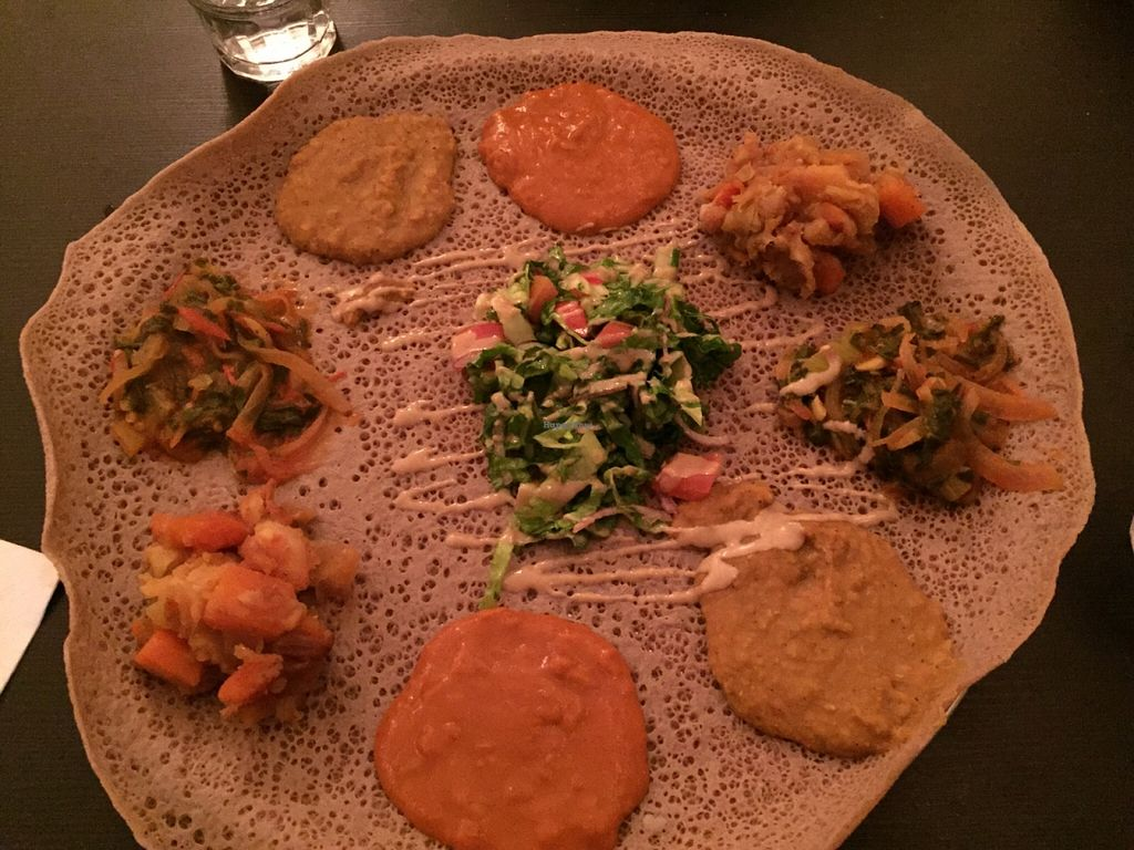 """Photo of Tenat  by <a href=""""/members/profile/reuvenk"""">reuvenk</a> <br/>Ingera platter with four traditional Ethiopian dishes, and salad <br/> January 3, 2016  - <a href='/contact/abuse/image/38946/130903'>Report</a>"""