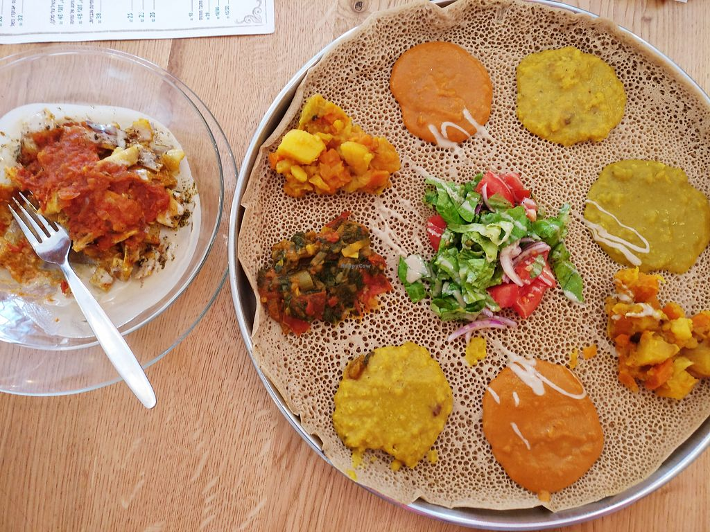 """Photo of Tenat  by <a href=""""/members/profile/KarinKoala"""">KarinKoala</a> <br/>""""Binto"""" - injera tray decorated with 4 dishes <br/> January 25, 2018  - <a href='/contact/abuse/image/38946/350814'>Report</a>"""