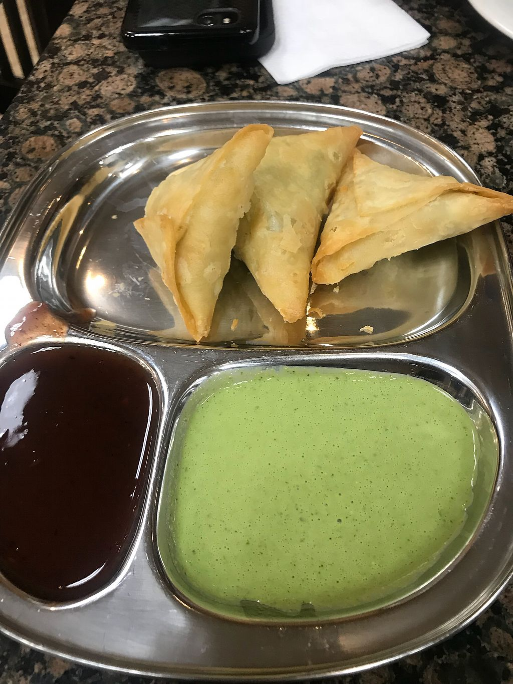 "Photo of Bhanu's Indian Grocery and Cuisine  by <a href=""/members/profile/Vegan_Ness"">Vegan_Ness</a> <br/>Vegetable samosa w/ tamarind sauce & cilantro sauce (lil spicy) <br/> January 2, 2018  - <a href='/contact/abuse/image/39050/342267'>Report</a>"